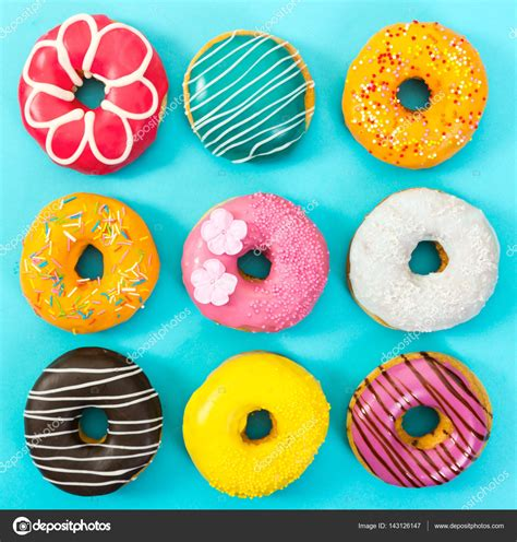 colorful donuts various colorful donuts on blue background stock photo