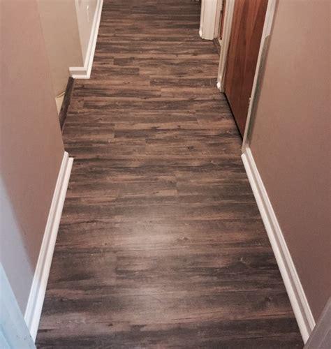vinyl plank flooring and trim quarter round installed hallway landing other