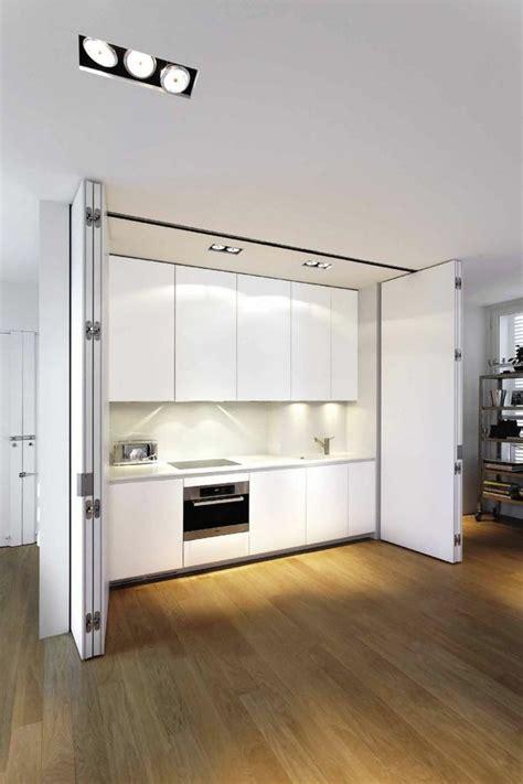 comment cacher une chaudi鑽e dans une cuisine les portes pliantes design en 44 photos furniture ideas