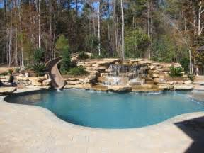 back yard water slide water fall traditional pool