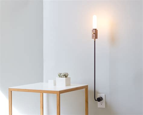Incredibly lightweight, Wald is a lamp anchored by a wall