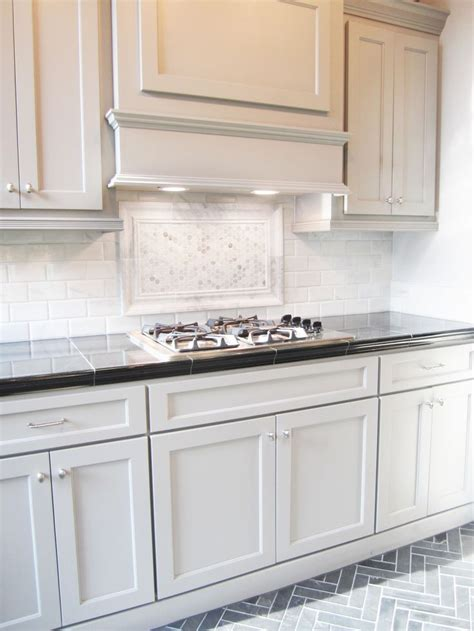 backsplash patterns for the kitchen this striking marble backsplash pairs well with these shaker style cabinets the traditional