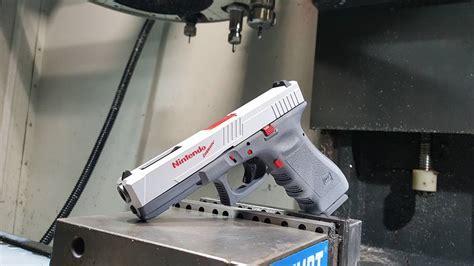 nintendo nes wii custom paint custom gun manufacturer creates a nintendo glock