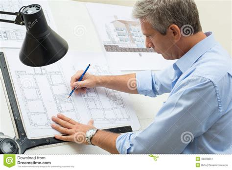 work from home design engineer architect working at drawing table stock image image of