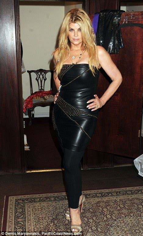 Palmer Spandek Maxi kirstie alley sizes up a leather dress on