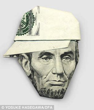 Five Dollar Bill Origami - gandhi in a baseball cap and the in a turban it