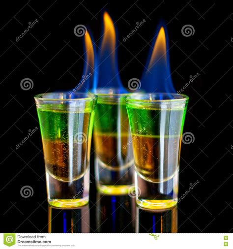 green cocktail black background burning green cocktail in shot glass on black background