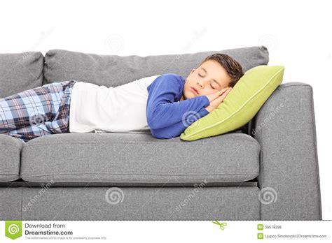 i sleep on a couch little boy sleeping on couch stock photo image of