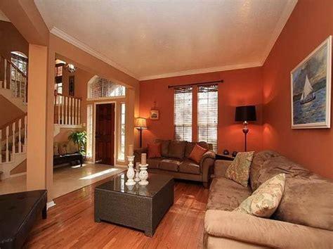 deep orange wall color  velvet beige sofa set