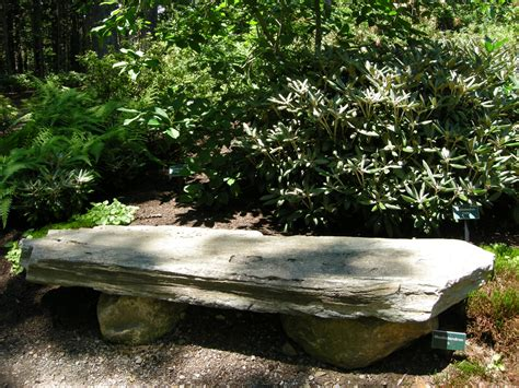 stone benches for gardens rustic stone bench in a woodland at the coastal maine