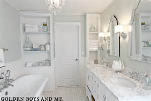 golden boys and me master bathroom pedestal tub white subway tile carrera