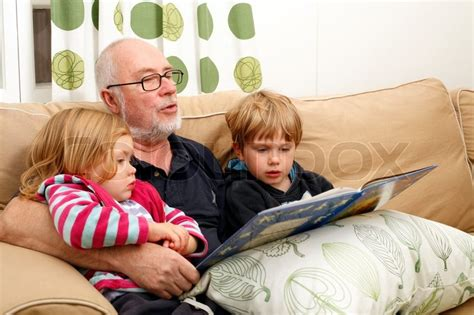 Scandinavian Livingroom by Grandpa Reading Book To His Grandchildren Stock Photo