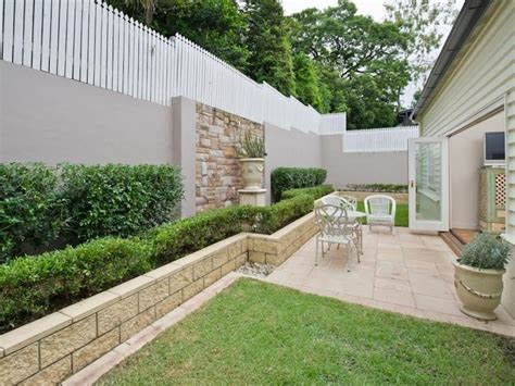 Backyard Wall Ideas by Landscaped Garden Design Using Grass With Retaining Wall Cubby House Gardens Photo 331210