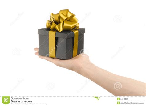 the theme of celebrations and gifts hand holding a gift