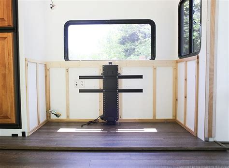 Pop Up Tv That Hides In The Fireplace by Installing A Tv Lift And Electric Fireplace Inside Our Rv