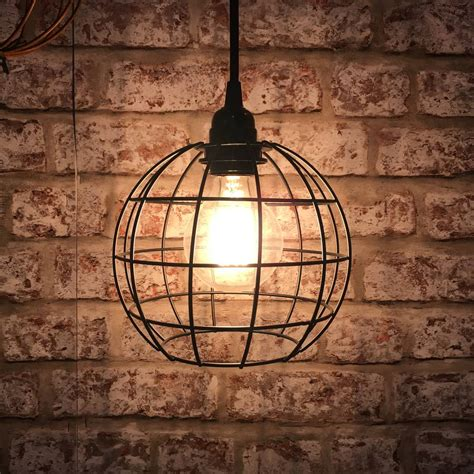 circular cage ceiling light in bronze and black by lime