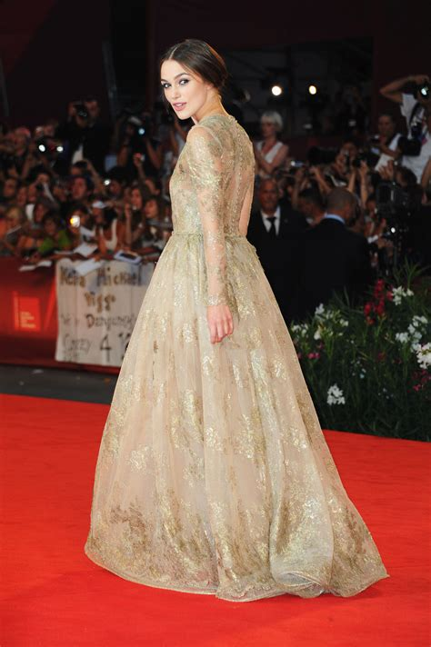 Keira Knightley At The Venice Festival by Keira Knightley In A Gown Golden Keira