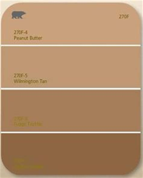 behr paint chips i like status bronze for front door and trim color glow