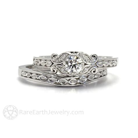 diamond engagement ring antique style with filigree leaf