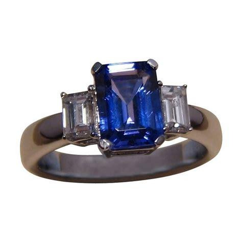 tanzanite trilogy ring emerald cut flashopal