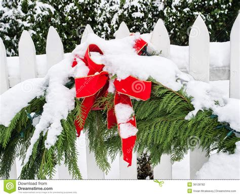 christmas lights on fence christmas decorations in snow stock photography image