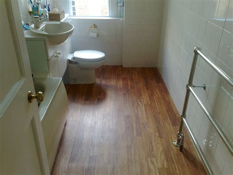 small bathroom spaces with vinyl wood plank flooring
