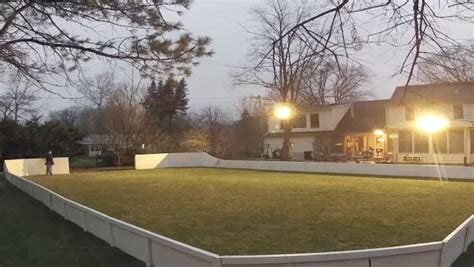 Backyard Rink Tarps by A Backyard Rink Get Made In Time Lapse Cbs News