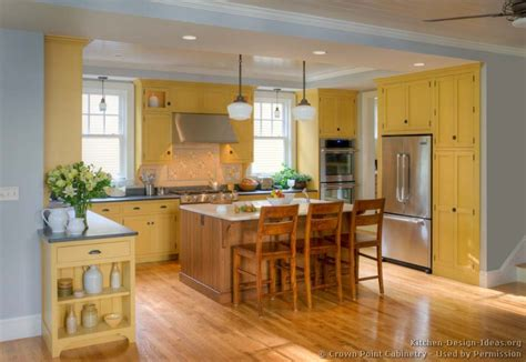 yellow cabinets kitchen traditional yellow kitchen with a custom wood island