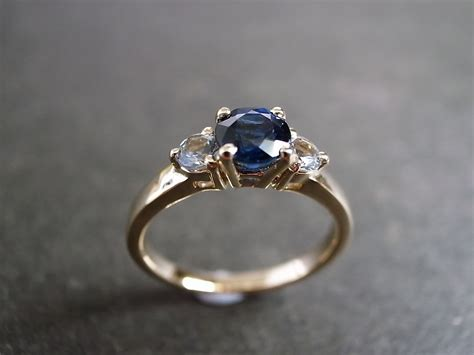 blue sapphire and white sapphire engagement ring on luulla