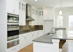 white cabinets with gray quartz countertops for kitchen