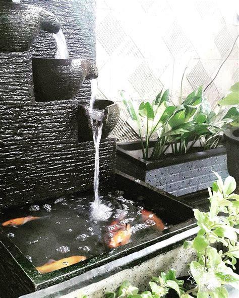 desain aquarium air tawar minimalis model kolam ikan dengan air mancur unik kolam ikan