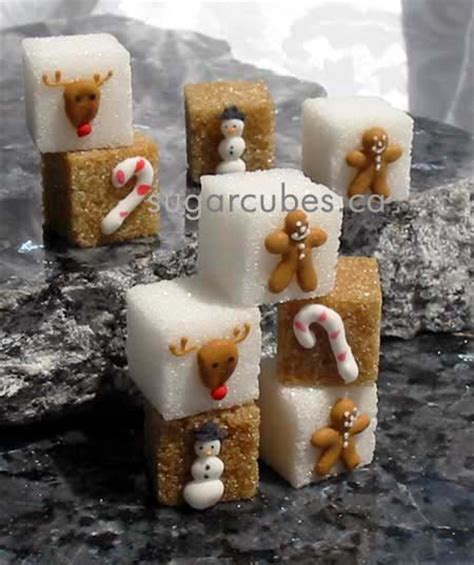 time decorated sugar cubes and miniature cookies