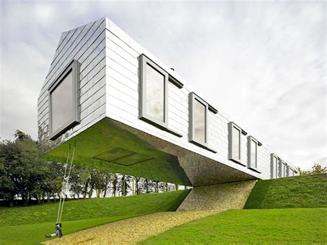 Cottage Home Designs 100 foot long balancing barn suspends hotel guests in mid