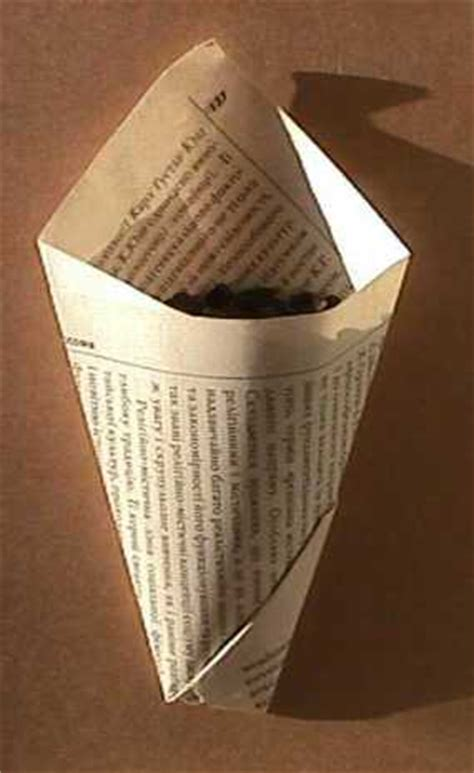 How To Fold Paper Into A Cone Shape - folding a paper container i remember my nan folding cones