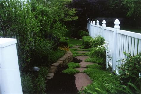 Paver Patio Design Decorative Walkway With A White Fence Lawn Systems Inc
