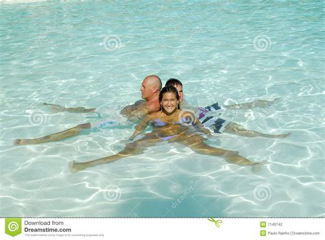 Family Swim Poll family in a swimming pool stock photography image 7149742