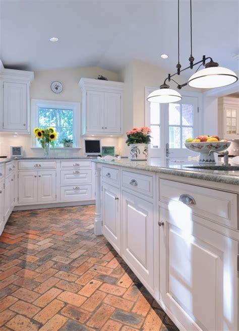 Basic white kitchen with #brick flooring. Holds the heat