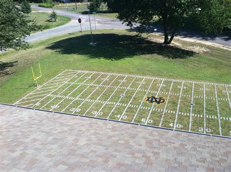 backyard football stadium notre dame fans turn front lawn into stadium replica