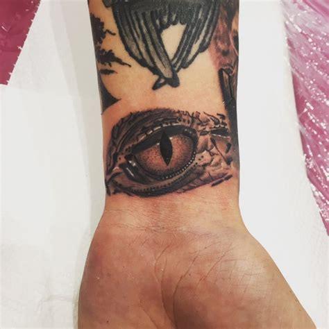 eye tattoo on wrist meaning 21 crocodile tattoo designs ideas design trends