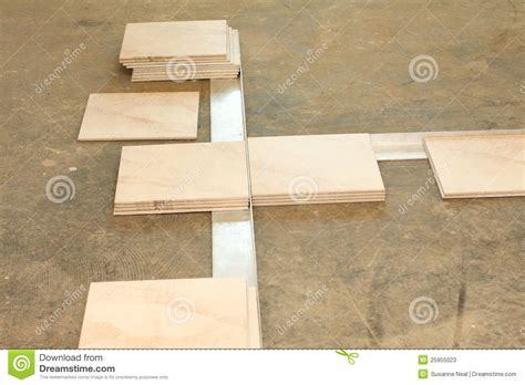 laying out ceramic tile flooring stock photos image