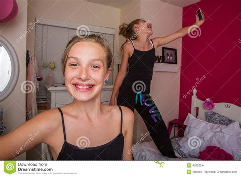 teen bedroom selfies two young girls playing in their room stock photo image 42602294