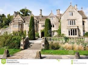Exterior and gardens of a victorian era english mansion