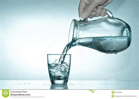 What To Fill Glass With Filling The Glass From A Pitcher With Water Stock Photo