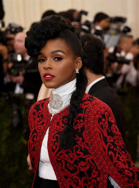 wearing a gown with african braid without makeup janelle monae long braided hairstyle long braided