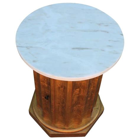 marble column table l modern scalloped gold leaf and white marble column side