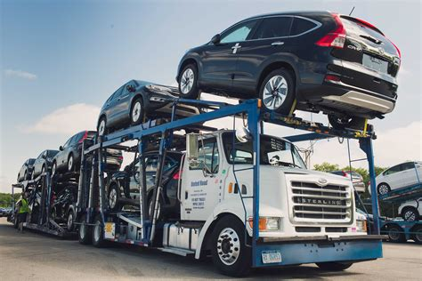 car carrier truck us car carriers driving an open highway automotive