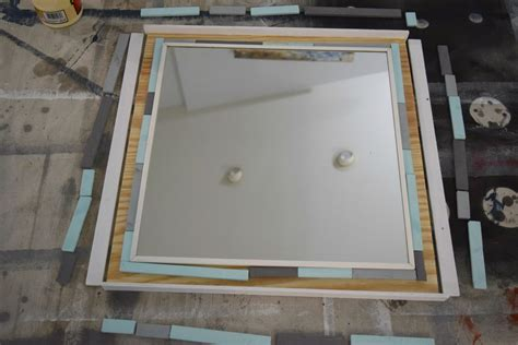 attaching the frame to your mirror diy wood scrap mirror frame our house now a home
