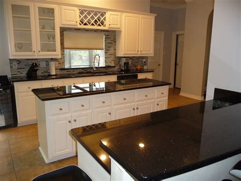 love black  white kitchens black galaxy granite