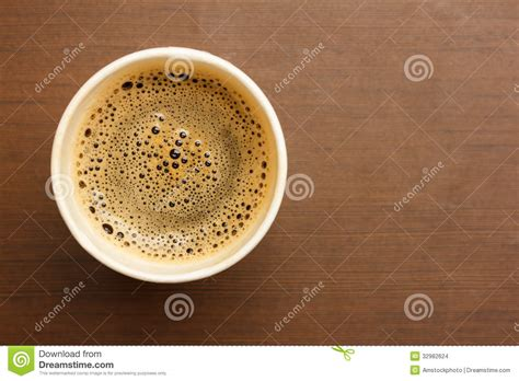 top of coffee cup top view of a paper cup of black coffee royalty free stock