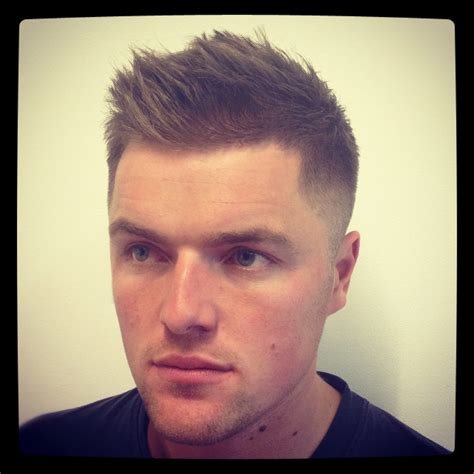 mens hairstyles cut yourself a man with a regular fade haircut and short hair on his